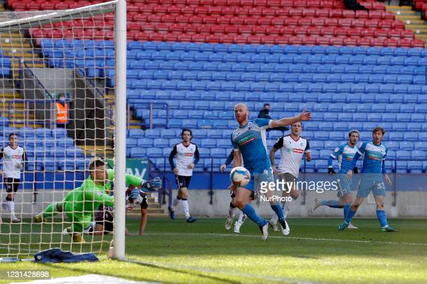 Barrows Jason Taylors shot is blocked by Bolton keeper Matt Gilks in the first half during the Sky Bet League 2 match between Bolton Wanderers and...