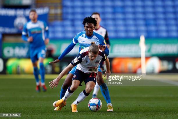 Barrows Kgosi Ntlhe challenges Boltons Lloyd Isgrove during the Sky Bet League 2 match between Bolton Wanderers and Barrow at the Reebok Stadium,...
