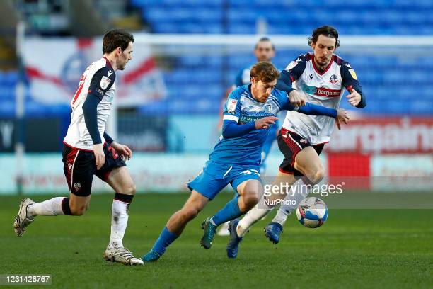 Barrows Luke James charges passed Boltons MJ Williams during the Sky Bet League 2 match between Bolton Wanderers and Barrow at the Reebok Stadium,...