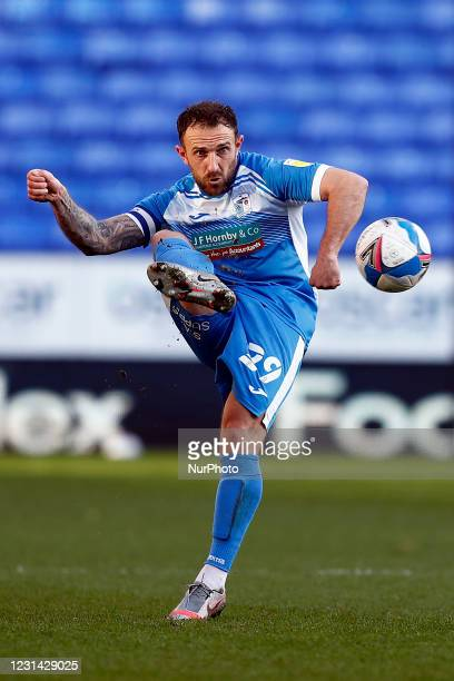 Barrows Neal Eardley plays the ball forward during the Sky Bet League 2 match between Bolton Wanderers and Barrow at the Reebok Stadium, Bolton on...