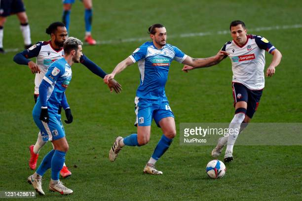 Barrows Ollie Banks battles with Boltons Anthoni Sarcevic during the Sky Bet League 2 match between Bolton Wanderers and Barrow at the Reebok...