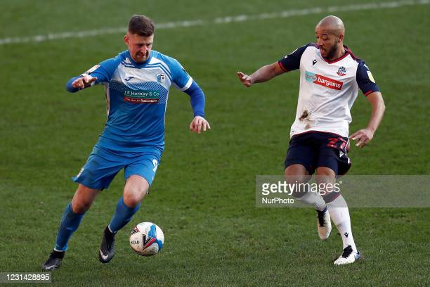 Barrows Scott Quigley battles with Boltons Alex Baptise during the Sky Bet League 2 match between Bolton Wanderers and Barrow at the Reebok Stadium,...