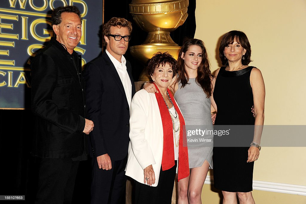 Barry Adelman, executive producer, actor Simon Baker, Dr. Aida Takia-O'Reilly, president, HFPA, actress Kristen Stewart and Orly Adelson, executive producer pose at the Hollywood Foreign Press Association's announcement of Jodie Foster as the recipient of the Cecil B. DeMille Award at the Beverly Hills Hotel on November 1, 2012 in Beverly Hills, California.