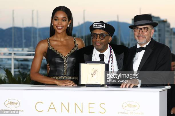 Barry Alexander Brown and Laura Harrier pose with director Spike Lee holding the Grand Prix award for 'BlacKkKlansman' and Laura Harrier next to him...