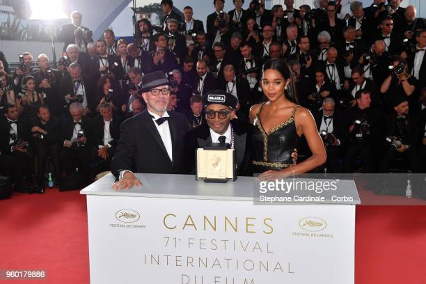 Barry Alexander Brown director Spike Lee posing with the Grand Prix award for 'BlacKkKlansman' and Laura Harrier next to him at the Palme D'Or Winner...