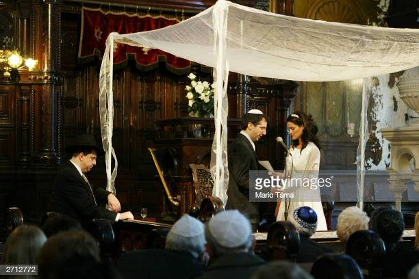 Barry and Hilit Edelstein are married in the historic Eldridge Street Synagogue in Manhattan's lower east side neighborhood November 9 2003 in New...