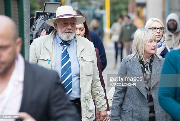 Barry and June Steenkamp, parents of late Reeva Steenkamp, arrive at the Pretoria High Court on June 14, 2016 on the second day of South African...