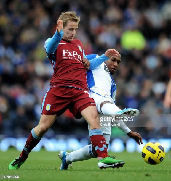 Barry Bannan of Aston Villa battles for the ball with Junior Hoilett of Blackburn Rovers during the Barclays Premier League match between Blackburn...