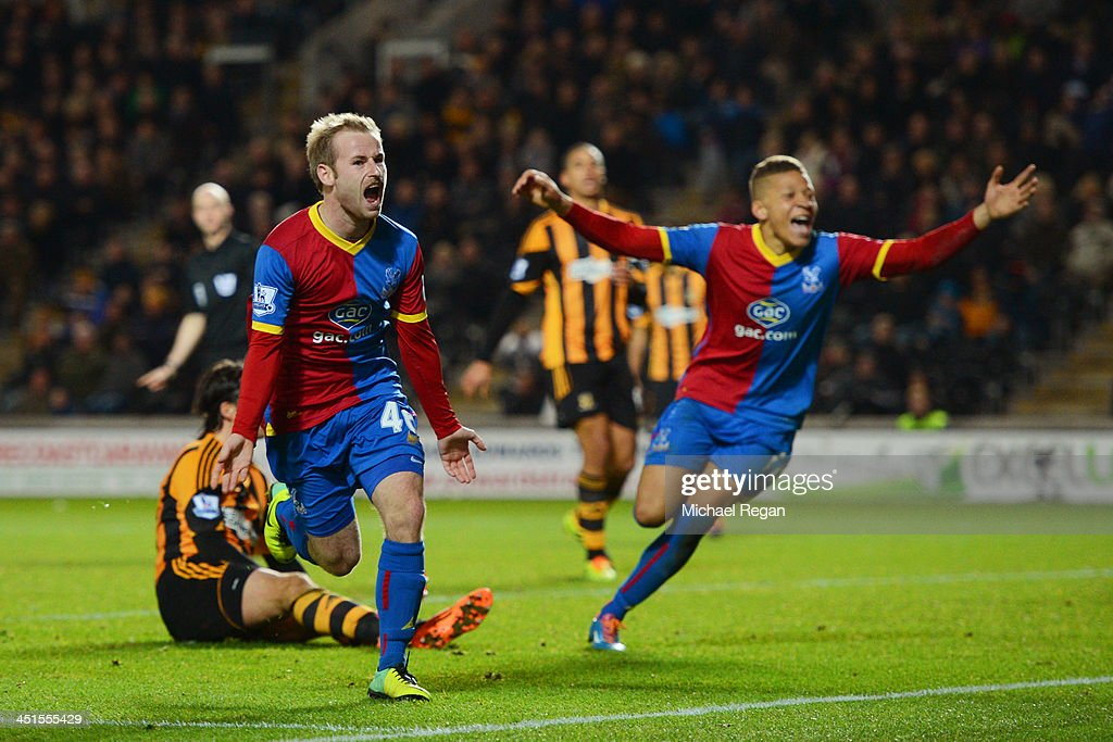 Barry Bannan (L) of Crystal Palace celebrates scoring the opening goal with team mates during the Barclays Premier League match between Hull City and Crystal Palace at KC Stadium on November 23, 2013 in Hull, England.
