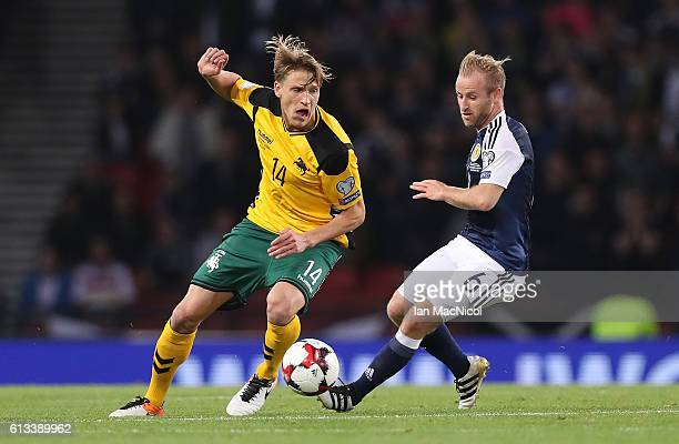 Barry Bannan of Scotland vies Vykintas Slivka of Lithuania during the FIFA 2018 World Cup Qualifier between Scotland and Lithuania at Hampden Park on...