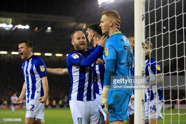 Barry Bannan of Sheff Weds congratulates Sheff Weds goalkeeper Cameron Dawson after he saved a penalty during the Sky Bet Championship match between...