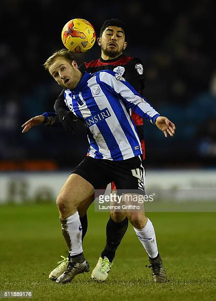 Barry Bannan of Sheffield Wednesday battles with Massimo Luongo of Queens Park Rangers during the Sky Bet Championship match between Sheffield...