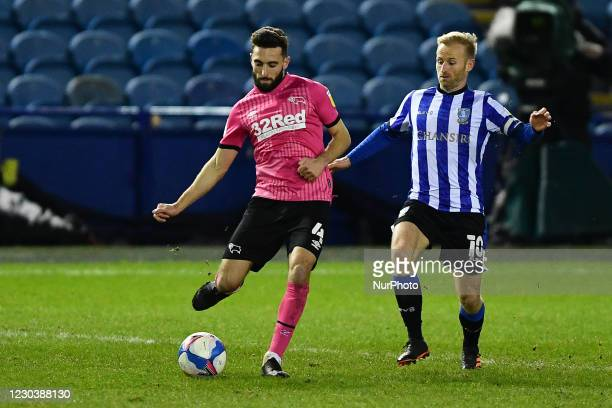 Barry Bannan of Sheffield Wednesday closes on GraemeShinnie of Derby County during the Sky Bet Championship match between Sheffield Wednesday and...