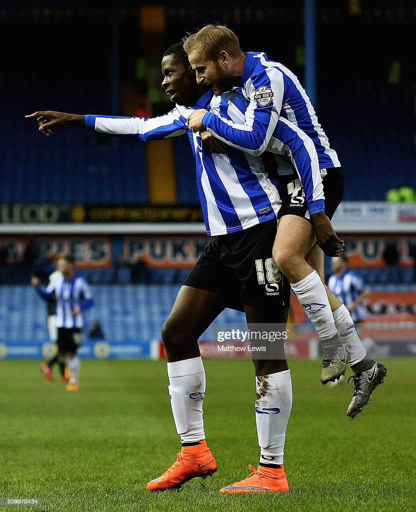 Barry Bannan of Sheffield Wednesday congratulates Lucas Joao on his goal during the Sky Bet Championship match between Sheffield Wednesday and Brentford at Hillsborough Stadium on February 13, 2016 in Sheffield, United Kingdom.
