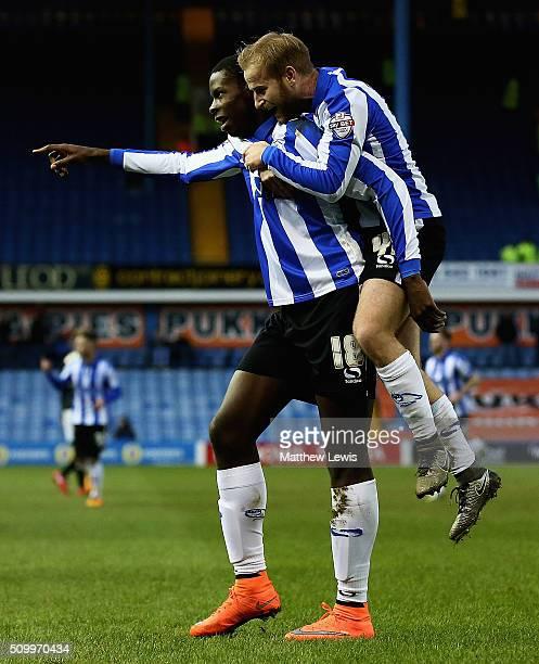 Barry Bannan of Sheffield Wednesday congratulates Lucas Joao on his goal during the Sky Bet Championship match between Sheffield Wednesday and...