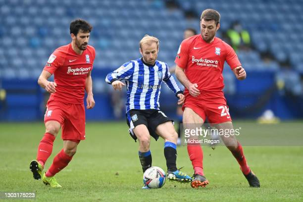 Barry Bannan of Sheffield Wednesday is tackled by Maxime Colin and Gary Gardner of Birmingham City during the Sky Bet Championship match between...