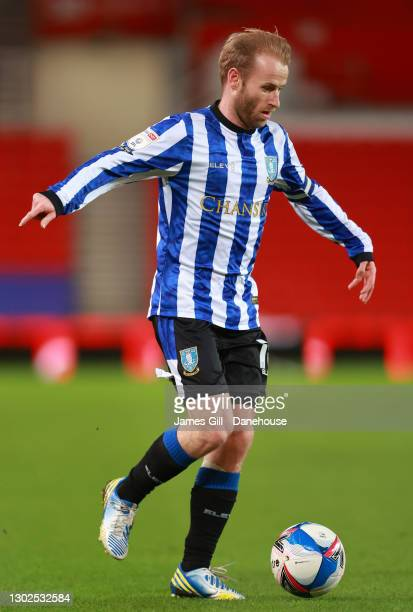 Barry Bannan of Sheffield Wednesday runs with the ball during the Sky Bet Championship match between Stoke City and Sheffield Wednesday at Bet365...