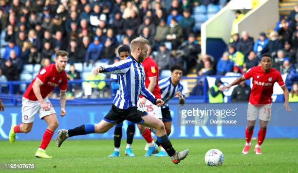 Barry Bannan of Sheffield Wednesday scores a penalty for his team making it 10 during the Sky Bet Championship match between Sheffield Wednesday and...