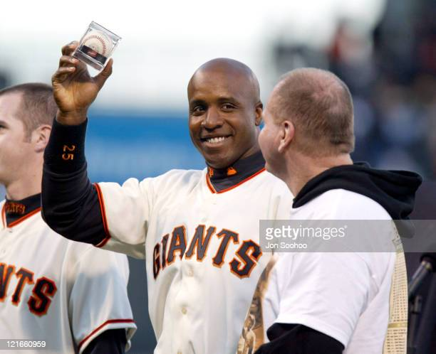 Barry Bonds holds the ball he hit for home run 660 prior to the game against the Dodgers in SBC Park in San Francisco California April 16 2004