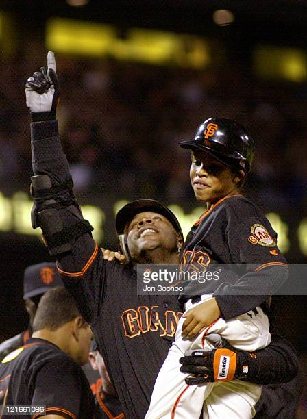 Barry Bonds is greeted at Home Plate by his son after hitting his 72nd home run of the season to Break Mark McGwire's single season record