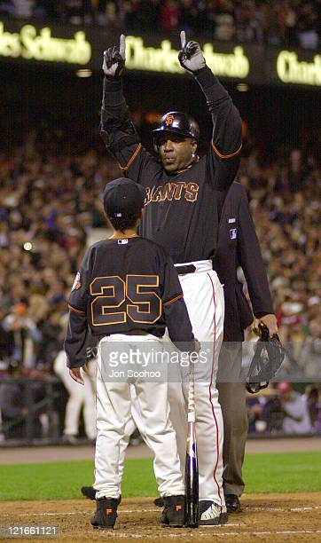 Barry Bonds is greeted at Home Plate by his son after hitting his 71st home run of the season to Break Mark McGwire's single season record