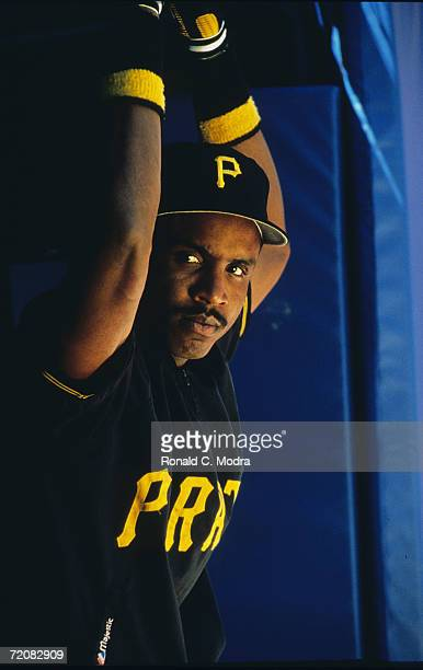 Barry Bonds of the Pittsburgh Pirates in the dugout priot to a game at Three Rivers Stadium in May 1990 in Pittsburgh, Pennsylvania.