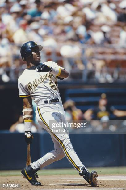 Barry Bonds of the Pittsburgh Pirates leans back and celebrates after hitting his 165th career home run during the Major League Baseball National...