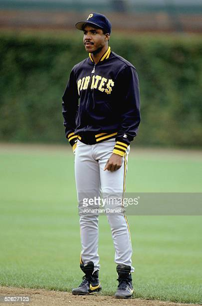Barry Bonds of the Pittsburgh Pirates stands on the field prior to a game against the Chicago Cubs in 1990 at Wrigley Field in Chicago Illinois