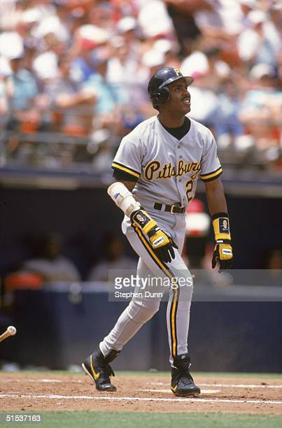 Barry Bonds of the Pittsburgh Pirates watches the flight of his hit against the San Diego Padres on May 27, 1992 at Jack Murphy Stadium in San Diego,...