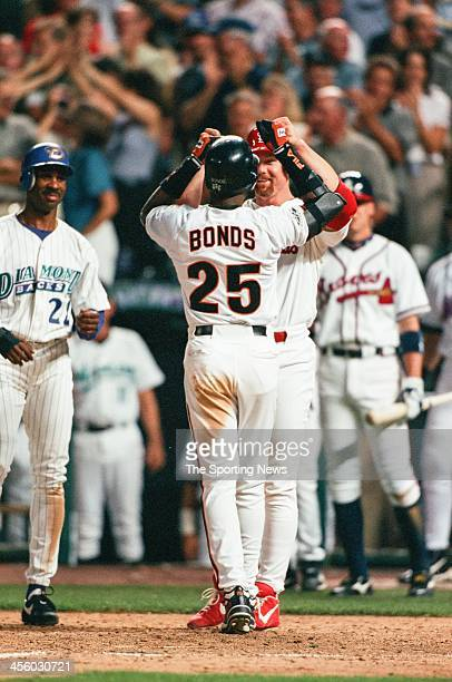 Barry Bonds of the San Francisco Giants and Mark McGwire of the St. Louis Cardinals celebrate during the All-Star Game on July 7, 1998 at Coors Field...