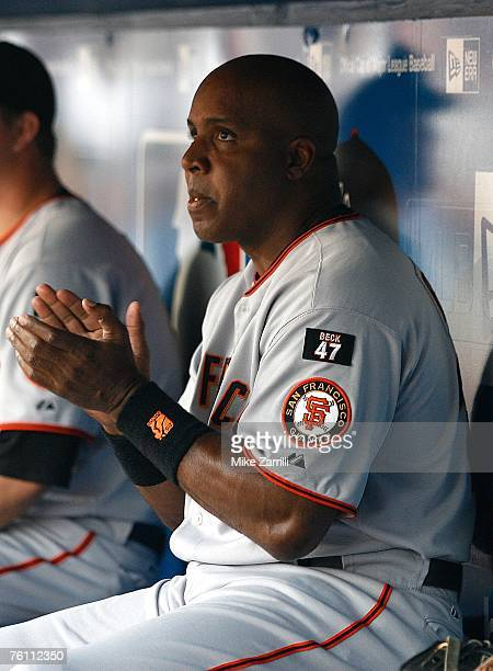 Barry Bonds of the San Francisco Giants applauds after a video tribute from Hank Aaron to Bonds is played before the game against the Atlanta Braves...
