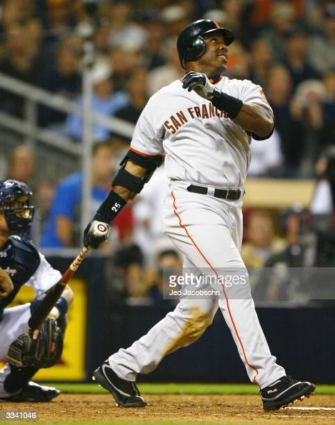 Barry Bonds of the San Francisco Giants flies out in the ninth inning against the San Diego Padres on April 11, 2004 at Petco Park in San Diego,...
