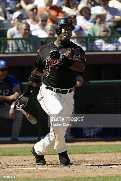 Barry Bonds of the San Francisco Giants gets an RBI single in the second inning against the Kansas City Royals during their spring training game on...