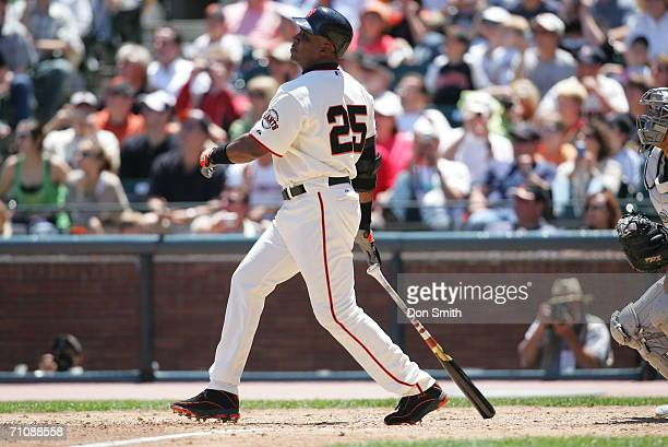 Barry Bonds of the San Francisco Giants hits career home run number 715 to pass Babe Ruth on the all time list during the game against the Colorado...