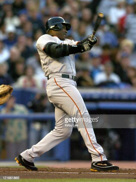 Barry Bonds of the San Francisco Giants hits his 678th career home run and 20th home run of the season on a threerun homer in the third inning...