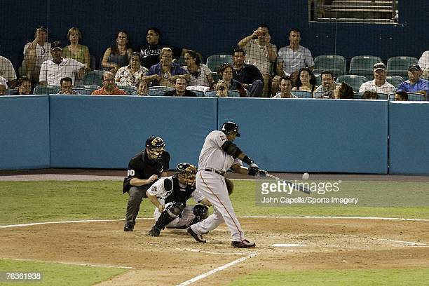 Barry Bonds of the San Francisco Giants hits home run during a MLB game against the Florida Marlins on August 18 2007 in Miami Florida