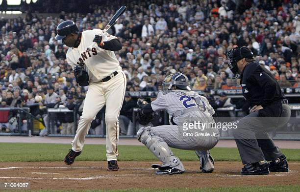Barry Bonds of the San Francisco Giants is hit by the pitch in the first inning of the game against the Colorado Rockies on May 26 2006 at ATT Park...