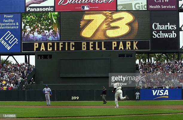 Barry Bonds of the San Francisco Giants rounds the bases after hitting his 73rd home run of the season against the Los Angeles Dodgers during the...