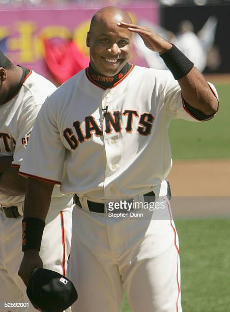 Barry Bonds of the San Francisco Giants salutes the crowd during an ovation as he is introduced in pregame ceremonies before taking on the Los...