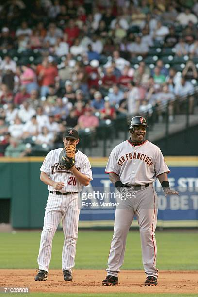 Barry Bonds of the San Francisco Giants smiles with Mike Lamb of the Houston Astros after being walked in the first inning May 15 2006 at Minute Maid...