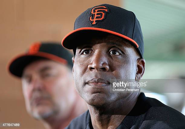 Barry Bonds of the San Francisco Giants speaks alongside manager Bruce Bochy during a press conference about his return to the organization as a...