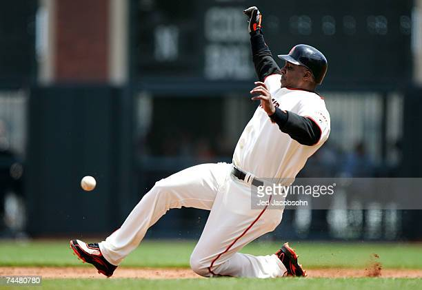 Barry Bonds of the San Francisco Giants steals second base in the 4th inning against the Oakland Athletics during a Major League Baseball game at...