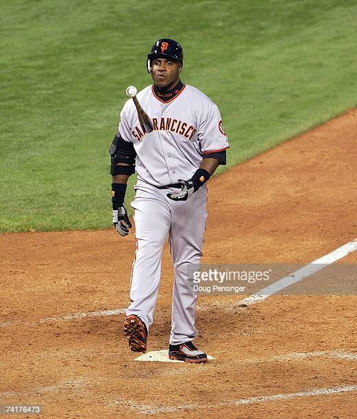 Barry Bonds of the San Francisco Giants tosses his bat during his ninth inning strike out against the Colorado Rockies as the Rockies defeated the...