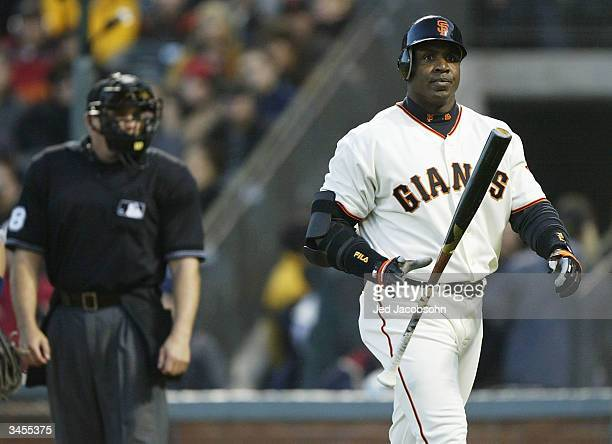Barry Bonds of the San Francisco Giants walks back to the dugout after being called out on strikes in the second inning against the San Diego Padres...