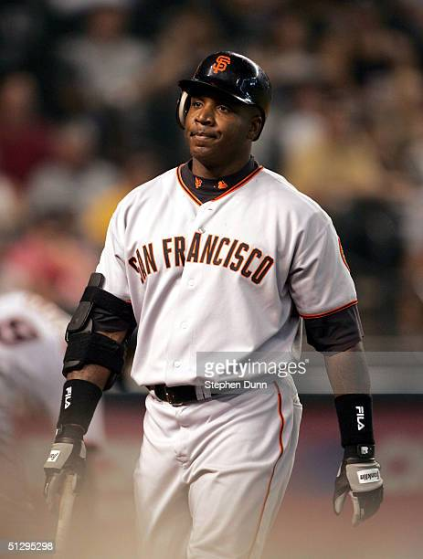 Barry Bonds of the San Francisco Giants walks back to the dugout after being called out on strikes in the fifth inning against the Arizona...
