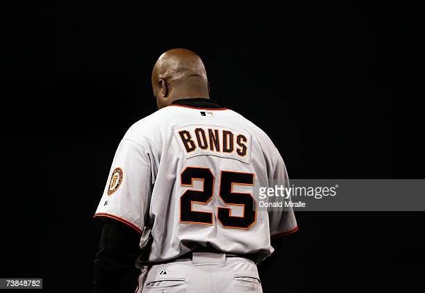 Barry Bonds of the San Francisco Giants walks off the field after striking out in the 8th inning against the San Diego Padres on April 9 2007 at...