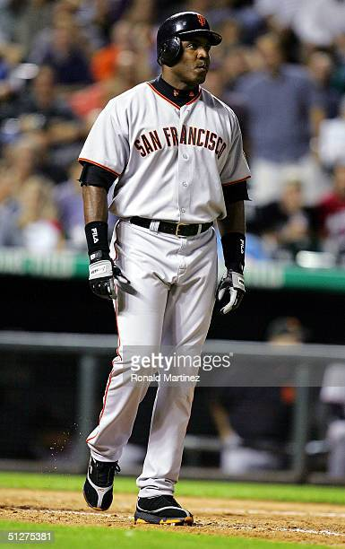 Barry Bonds of the San Francisco Giants walks to first base after being hit by a pitch from Brian Fuentes of the Colorado Rockies on September 8 2004...