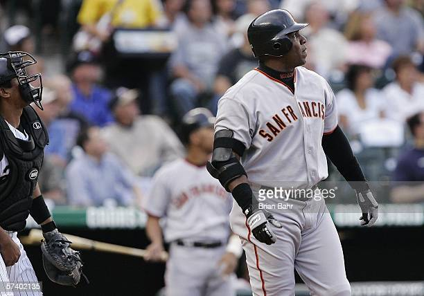 Barry Bonds of the San Francisco Giants watches his first home run of the season fly out of left field against the Colorado Rockies in the first...
