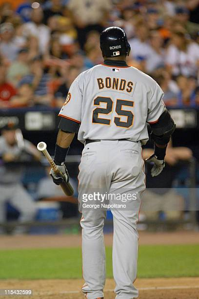 Barry Bonds walks back to the dugout after striking out in the 7th inning during the game between the San Francisco Giants and the New York Mets at...