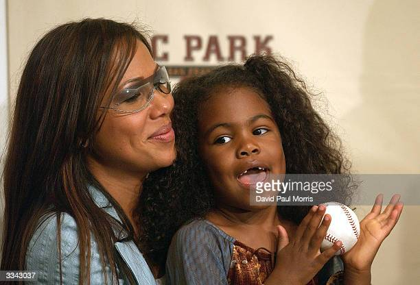 Barry Bonds' wife Liz Bonds and his daughter Aisha Bonds with Barry's 660th home run ball during a press conference after Bonds hit his 660th career...